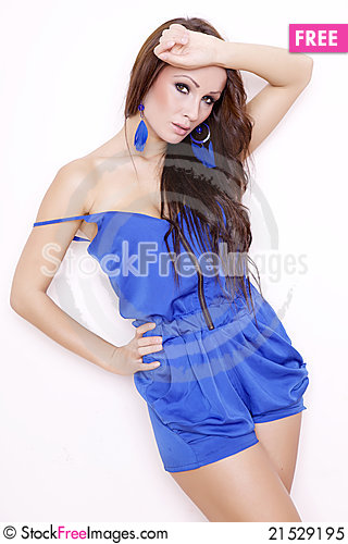 Free Sexy Brunette Posing In Blue Dress. Royalty Free Stock Photo - 21529195