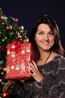 Free Happy Woman With Christmas Gift Royalty Free Stock Photography - 21521607