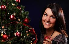 Woman Are Decorating The Christmas Tree Stock Photography