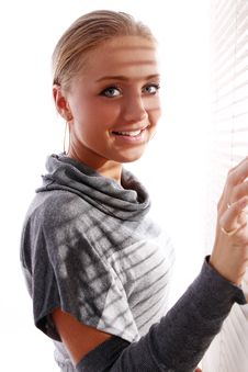 Free Beautiful Woman In Gray Pullover Beside A Window Royalty Free Stock Images - 21521999