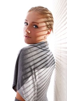 Free Beautiful Woman In Gray Pullover Beside A Window Stock Image - 21522021