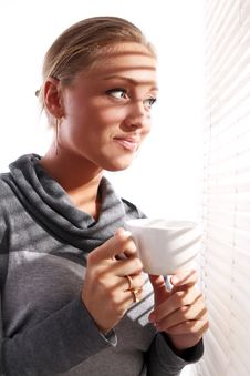 Free Beautiful Woman With Cup Of Coffee Beside A Window Royalty Free Stock Photo - 21522025