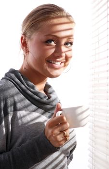 Free Beautiful Woman With Cup Of Coffee Beside A Window Stock Photo - 21522040