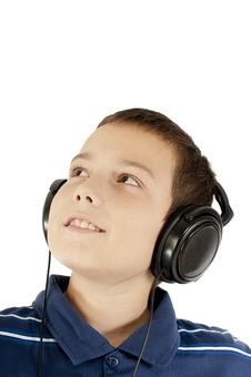 Free The Boy Listens To Music Royalty Free Stock Photo - 21522375