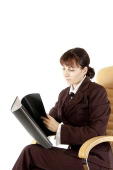 Free The Business Lady Sits With A Folder For Papers Royalty Free Stock Photos - 21522378