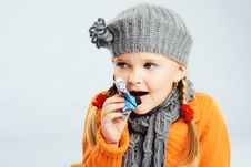 Free Lovely Little Girl Eating A Candy Stock Photos - 21524743