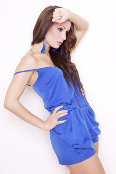 Sexy Brunette Posing In Blue Dress.