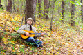 Free Man Is Playing A Guitar In Autumn Forest Royalty Free Stock Image - 21536006