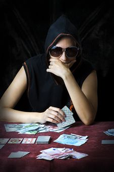 Poker Face. Person Playing Poker Royalty Free Stock Photos