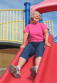 Free Senior Woman Going Down A Slide Royalty Free Stock Photos - 21554388