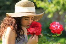 Free Girl Smelling Roses Royalty Free Stock Photo - 21555595