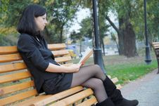 Free Girl Reading A Book On The Nature Royalty Free Stock Image - 21556176