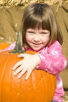 Free Little Girl With Pumpkins Royalty Free Stock Photo - 21576485