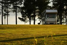 Free Mobile Home On Camping Site Into The Sunset. Stock Image - 21577611
