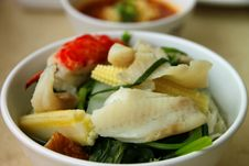 Fishes And Mixed Vegetables Dish Stock Image