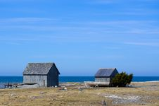 Free Two Huts And A Boat By The Sea Stock Image - 21586231