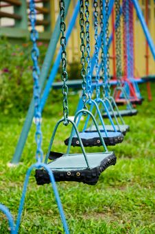 Free Blue And Red Swings Hanging In The Park Royalty Free Stock Photo - 21597605