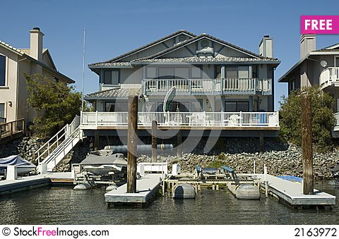 Free Executive House On The Water Stock Photography - 2163972