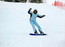 Free Smiling Girl On The Snowboard Royalty Free Stock Photos - 2161048