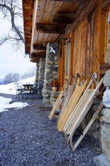 Wooden Sledges In Front A Chalet Royalty Free Stock Photos