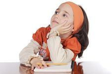 Adorable Girl Studying Stock Image