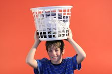 Free Boy Holding Laundry Stock Photo - 2167440