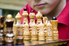 Young Chessmaster (Serious) Royalty Free Stock Photo