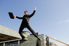 Businessman Jumping In The Street Royalty Free Stock Photo