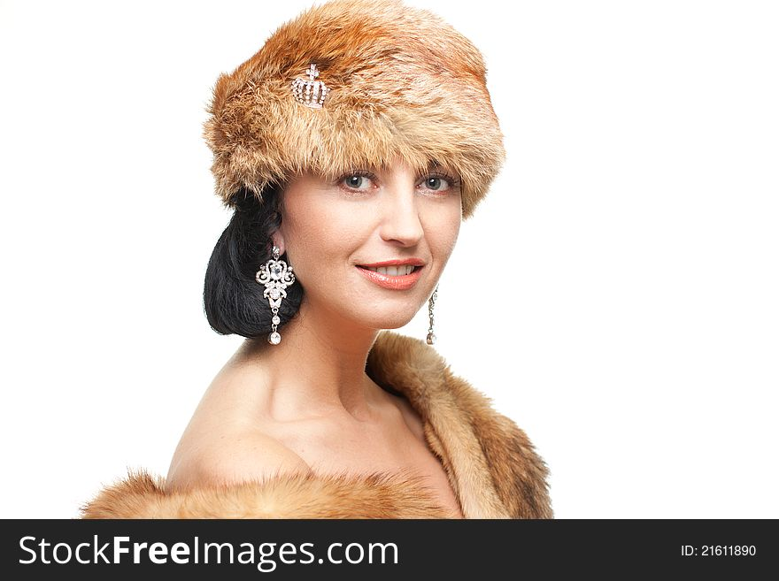 Smiling mature woman in fur isolated on white