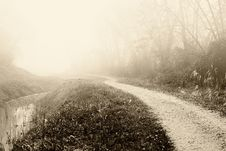 Free Country Road Near The Canal Royalty Free Stock Images - 21625999