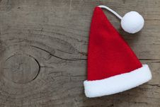 Free Santa Hat On Wooden Background Royalty Free Stock Photos - 21636928