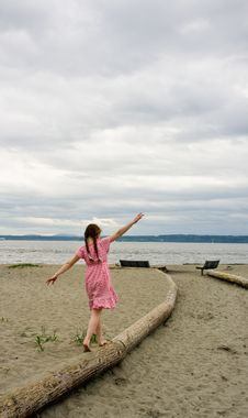 Free Young Girl Balancing On Log At Beach Royalty Free Stock Images - 21643139
