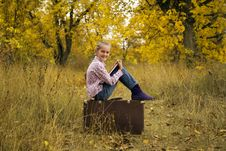 Free Little Girl Is Reading A Book In Autumn Stock Photography - 21644442