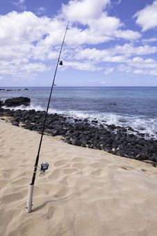 Fishing Pole On Sandy Beach Royalty Free Stock Photos
