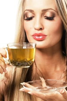 Beautiful Woman With A Cup Of Green Tea Stock Photos