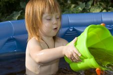 Free Child Playing In A Pool Stock Images - 21656204