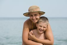 Free Mother With The Son Smile Against The Sea Royalty Free Stock Photography - 21674507