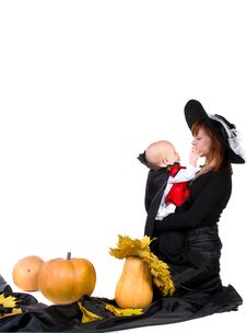 Halloween Baby With Mother Near Pumpking Stock Photography