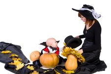 Free Halloween Baby With Mother Near Pumpking Stock Photo - 21675350