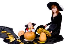 Free Halloween Baby With Mother Near Pumpking Royalty Free Stock Photos - 21675358