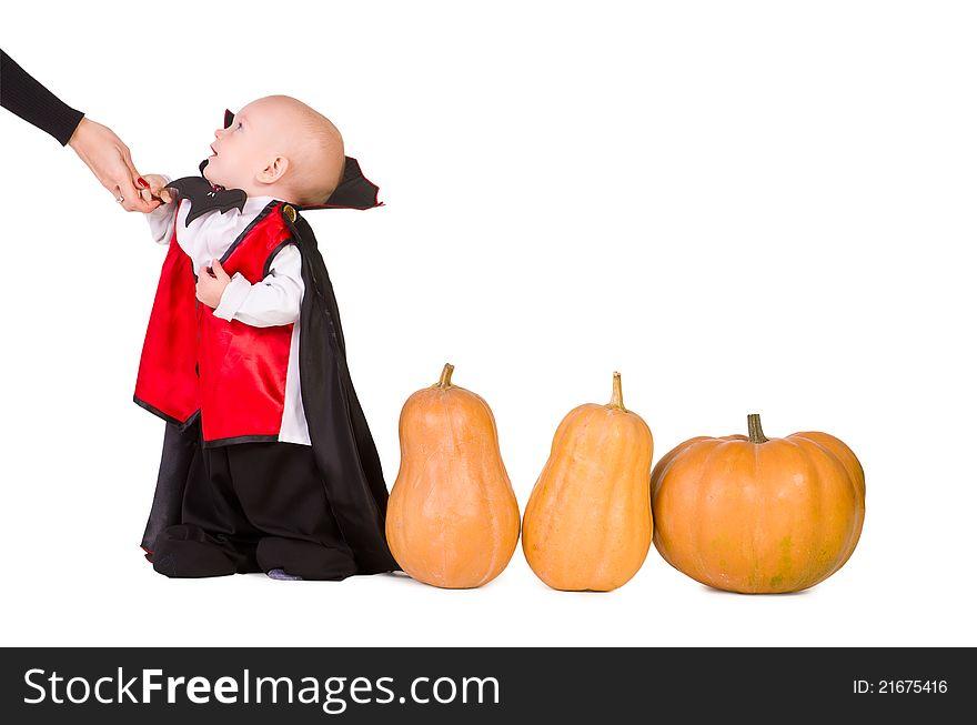 Halloween baby boy with pumpking