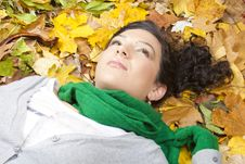 Free Young Woman Resting On Leaves Royalty Free Stock Photo - 21682845