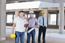 Team Of Architects On Construciton Site Royalty Free Stock Photos