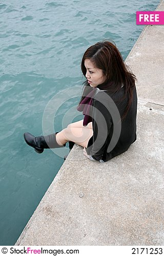 Free Asian Girl Sitting On Edge Stock Photos - 2171253