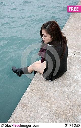 Free Asian Girl Sitting On Edge Stock Photos - 2171253