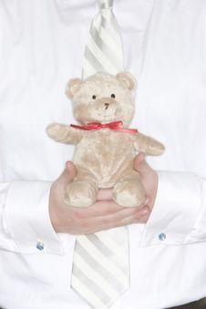 Businessman Holding Teddy Bear Royalty Free Stock Photography