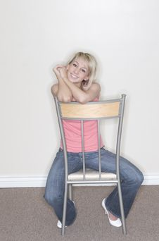 Free Pretty Woman Sitting On Chair Royalty Free Stock Images - 2176779