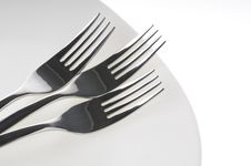 Free Forks On A Plate  Over White Royalty Free Stock Photography - 21708987