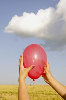 Free Hand Holding Red Balloon. Stock Photo - 21710240