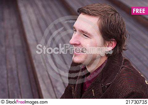Free Young Man Smiling And Looking Down Stairs Royalty Free Stock Photo - 21730735